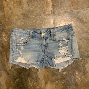 AE size 2 Super Low Shortie peekaboo Jean  shorts